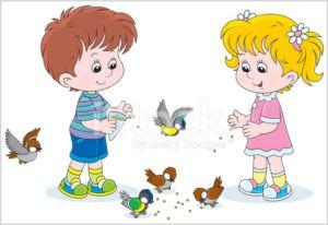 Дети кормят птиц