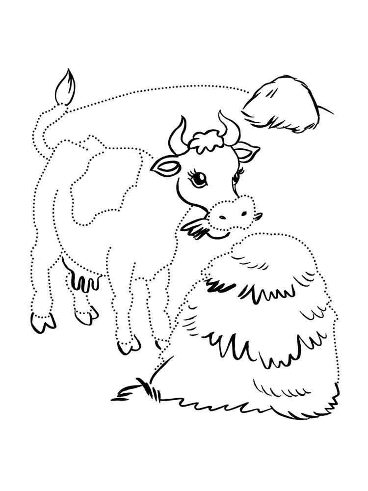 корова у стога сена